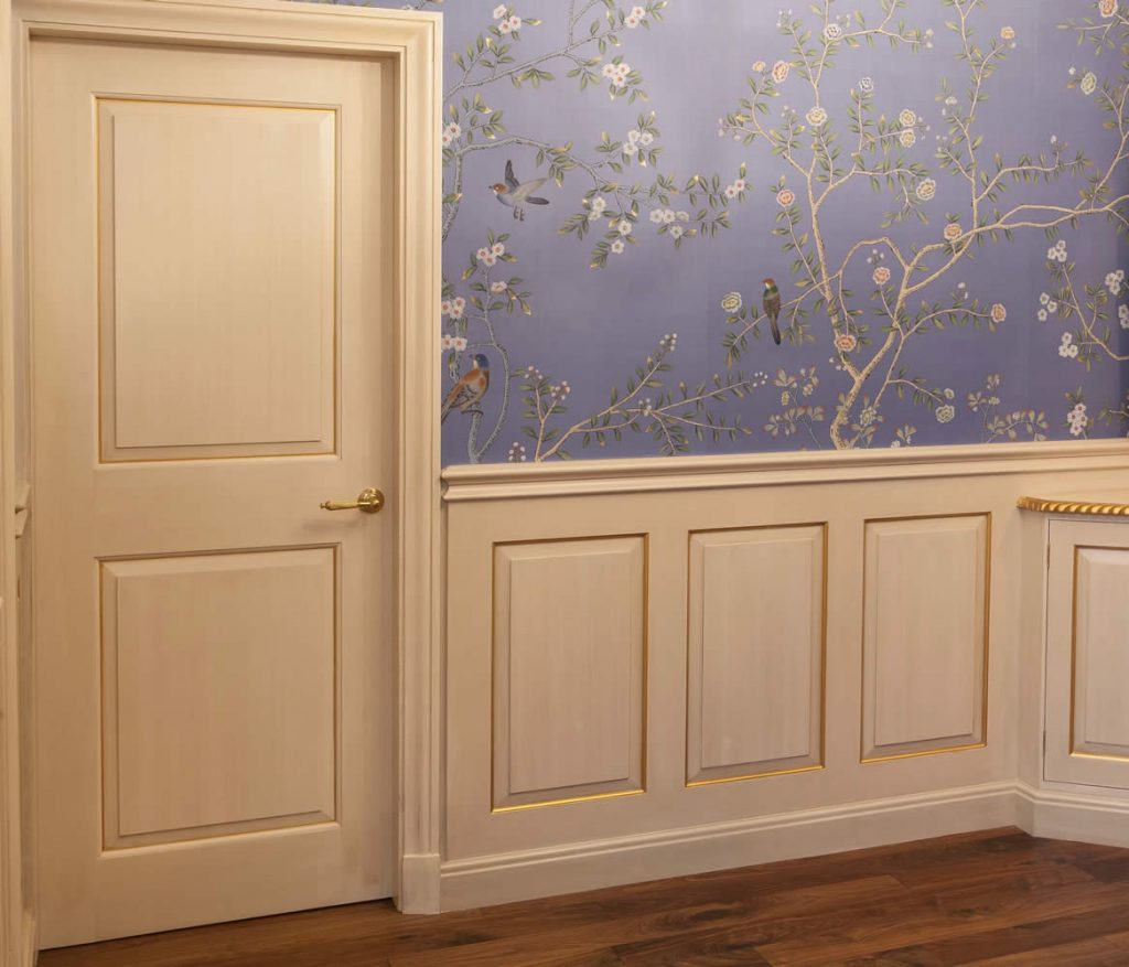 Interior view of an Ante-room installed with dado height panelling, internal doors and fitted cabinetry incorporating a <i>Georgian design</i> using raised and fielded panels set with an Ovalo moulding. Installation was completed with hand decoration, gilt accents and finished with <i>De Gournay</i> hand painted, gold-leafed chinoiserie wall panels.<br>Private Residence. London. 2015.