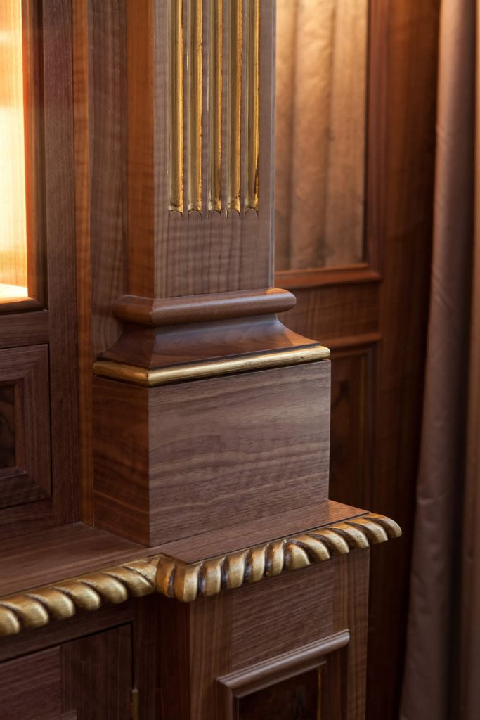 "Bookcase detail showing fluted pilasters, hand finished and set on plain pillar bases with carved gadrooned front edge detail.<br>Private Residence. London. 2015. <br><br> ""Carmen's eye to detail, her feel for the property and application of her customers' requirements is second to none."" <br> Mr. R. Baker"